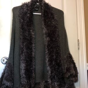 """Knit shawl type jacket with faux fur """"outline""""."""